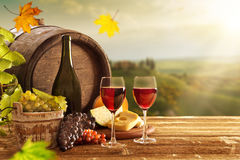 Delicious cheeses and wine on old wooden table. Stock Photo
