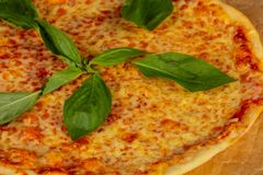 Delicious caprese pizza. Delicious cheesy and big caprese pizza royalty free stock photography