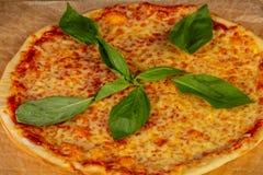Delicious caprese pizza. Delicious cheesy and big caprese pizza stock photos