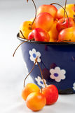 Delicious cherries. Delicious rainier cherries in a small old pan Stock Photos
