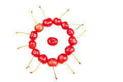 Cherry in a circle made of cherries Royalty Free Stock Photo