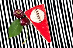 Cherry cake on striped background from above Stock Photography