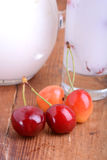 A delicious cherry milkshake on wooden plate Royalty Free Stock Image