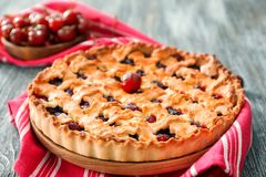 Delicious cherry pie. On table stock images