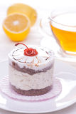 Delicious of cherry tea cake on wooden table Stock Image