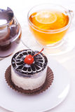 Delicious of cherry tea cake on wooden table Royalty Free Stock Image