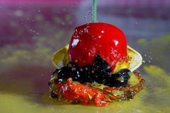 Delicious cherry with water drops. Ornate frozen water drops as background images Royalty Free Stock Photos