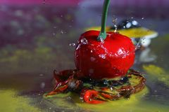 Delicious cherry with water drops. Ornate frozen water drops as background images Royalty Free Stock Image