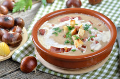 Delicious Chestnut Soup. With celery, croutons and roasted bacon from South Tyrol royalty free stock photos
