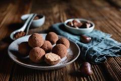 Chestnut truffles coated with cocoa powder. Delicious chestnut truffles coated with cocoa powder stock photos