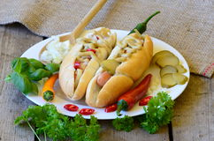 Delicious Chicago style hot dog on wooden background Stock Photography