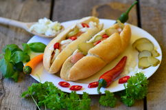 Delicious Chicago style hot dog on wooden background Royalty Free Stock Image
