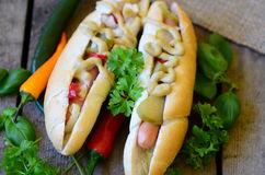 Delicious Chicago style hot dog on wooden background Royalty Free Stock Images