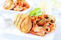 Delicious chicken breast with pasta Stock Photo