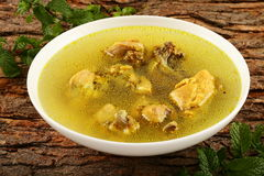 Delicious chicken broth with herbs and spices. Royalty Free Stock Images