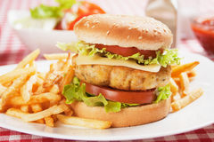 Delicious chicken burger. With cheese, tomato and lettuce Stock Images