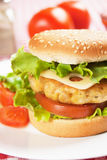 Delicious chicken burger. With cheese, tomato and lettuce Royalty Free Stock Photo