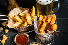delicious chicken fingers served with french fries and beer at local pub Stock Photo