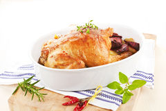 Delicious chicken with fresh herbs and vegetables. Stock Image