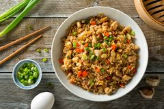 Chicken Fried Rice. Delicious chicken fried rice with egg, carrot, garlic and green onion Stock Photo