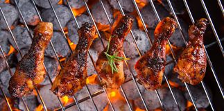 Delicious chicken legs on garden grill Stock Photo