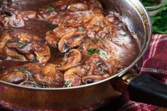 Delicious chicken marsala on frying pan. Italian cuisine royalty free stock image