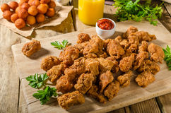 Delicious chicken popcorn. With hot tomato souce and potato croquettes stock photos