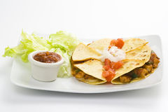 Delicious chicken quesadilla and fresh vegetables. Isolated Stock Photo
