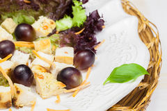 Delicious chicken salad with grapes and croutons Royalty Free Stock Photography