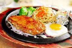 Delicious chicken and spaghetti. What would you like to eat? stock photo