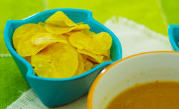 Delicious chifles of plantains inside of magenta bowl Royalty Free Stock Photography