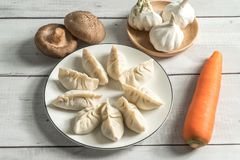 Delicious chinese dumpling on the white table. The homemade traditional chinese food dinner meal steamed asia plate lunch wrapped stuffed jiaozi new gourmet royalty free stock photos