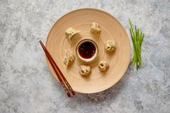 Delicious chinese dumplings served on wooden plate royalty free stock photos