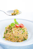 Delicious Chinese egg fried rice on dining table Stock Photography