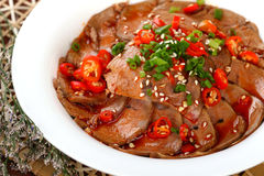 Delicious Chinese food cold dish- hot pepper goose. Liver with beautiful background in studio Royalty Free Stock Photos