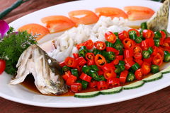 Delicious Chinese food fried dish - Steamed fish. With beautiful background in studio Royalty Free Stock Photo