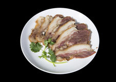 Delicious Chinese food. Pig`s cheek meat, pieces of meat cut from a pig`s head served as a cold dish to go with drinks, some marinated food in China Stock Image
