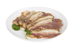 Delicious Chinese food. Pig`s cheek meat, pieces of meat cut from a pig`s head served as a cold dish to go with drinks, some marinated food in China Royalty Free Stock Image