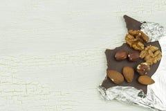 Delicious chocolate in aluminum foil Stock Photos