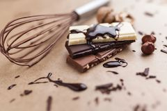 Delicious chocolate bars with melted chocolate Royalty Free Stock Images