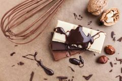 Delicious chocolate bars with melted chocolate Royalty Free Stock Photo