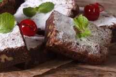 Delicious chocolate brownie cake with nuts closeup horizontal Royalty Free Stock Images