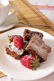Delicious Chocolate Brownie and Strawberry with cocoa milk Royalty Free Stock Images