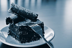 Delicious chocolate cake. A piece of rich decorative chocolate cake on a white plate Stock Photography