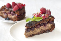 Delicious Chocolate cake with berries Stock Photo