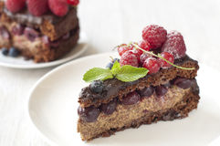 Delicious Chocolate cake with berries Stock Photos