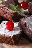 Delicious chocolate cake brownies with nuts and cherries macro Stock Photo