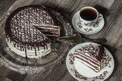 Delicious chocolate cake with creamy cream with coffee Stock Photos