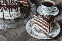 Delicious chocolate cake with creamy cream with coffee Royalty Free Stock Photo
