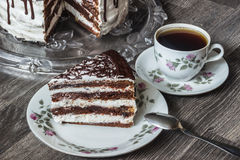 Delicious chocolate cake with creamy cream with coffee Stock Images